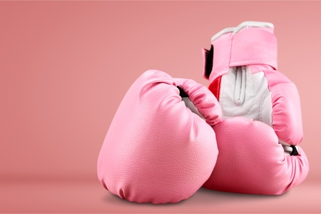 Pink boxing gloves on background Stock Photo