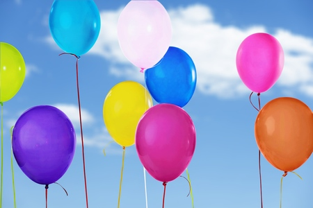 Colorful Helium balloons on sky background Stock Photo