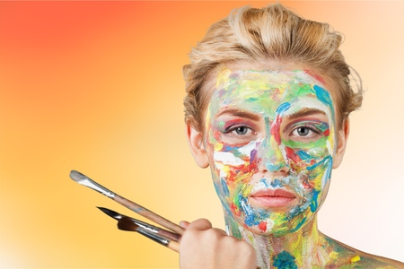 Woman artist with paint face