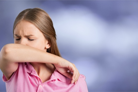 Young woman scratching her nose Stock Photo