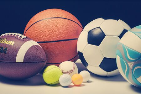 Set of balls for different sports on white table background