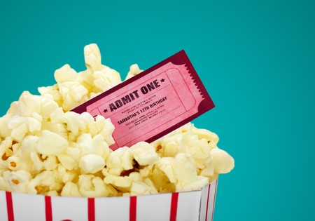 Popcorn food in box  and ticket on background Фото со стока