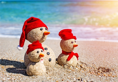 Sandy snowmen. Holiday concept can be used for New Years and Christmas Card
