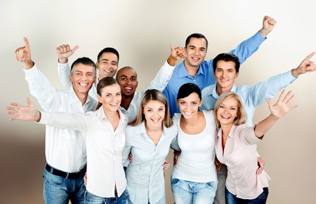 Smiling young business people on office background