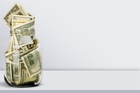 Glass jar for money on background Stok Fotoğraf