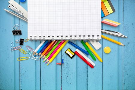 School and office supplies, booklet, paint, pencils isolated on white background Banque d'images