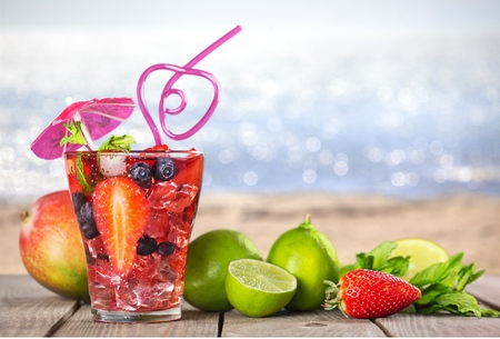 Fruit cocktail on a beach background