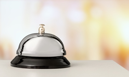 Vintage hotel reception service desk bell on blurred background, bokeh Фото со стока - 108416797