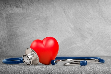 Red heart and a stethoscope on backgrouund