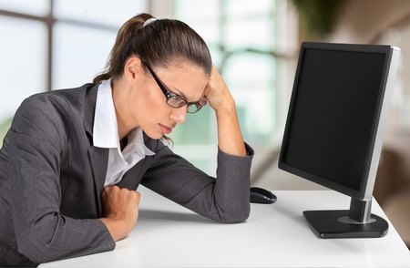 Fatigued businesswoman tired of computer work