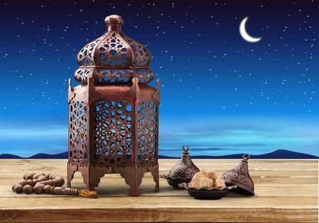 A golden Ramadhan lamp on city background