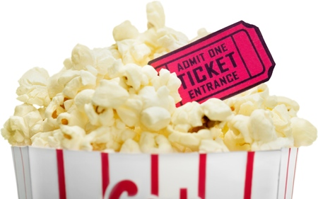 A bucket of popcorn and a movie ticket on white background