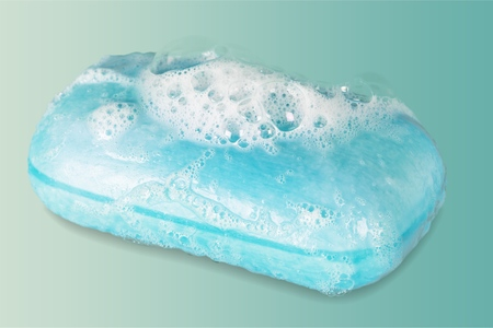 Bar of Blue Soap with Bubbles Stock Photo