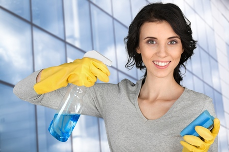 Cleaning woman on window background
