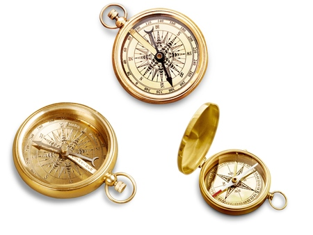 Brass antique compass on white background