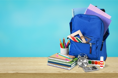 Blue School Backpack on a wooden table. Stock Photo