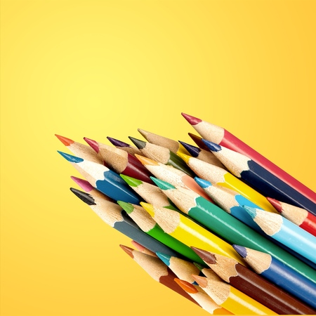 Pencil colors on yellow background