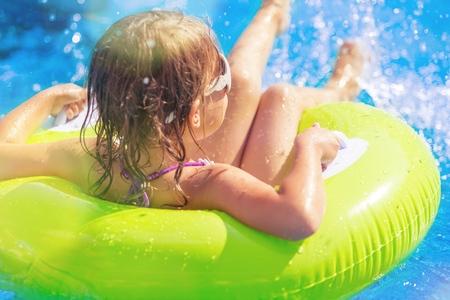 Beautiful little girl at swimming pool Stock Photo