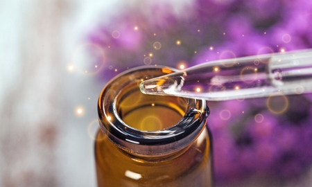 Lavender essential oil in a bottle and a dropper