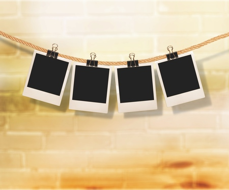 Old photo frames hanging on the cloth line Stockfoto