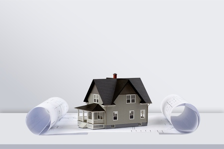 Mini house on blue print