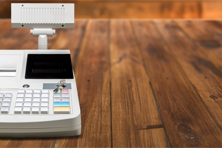 Cash register with LCD display on wooden background Archivio Fotografico