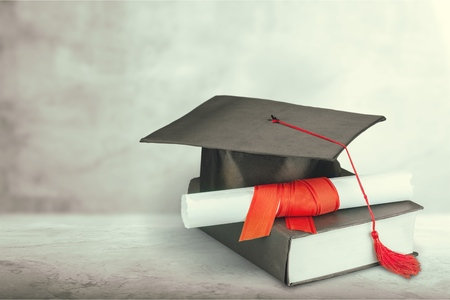 Graduation mortarboard on a book