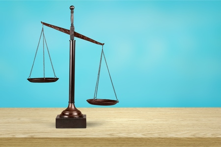 Law scales on a wooden table Stock Photo