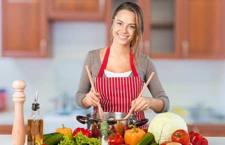 Young beautiful woman Cooking in the kitchen