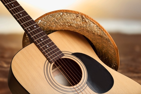 Acoustic guitar close up on blurred background