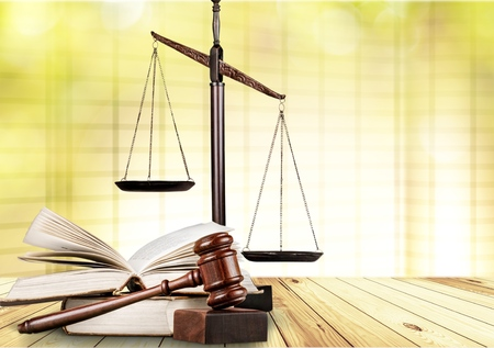 Justice Scales, books and wooden gavel