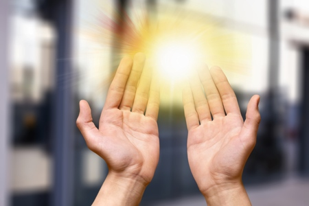 Human hands holding with flashlight background