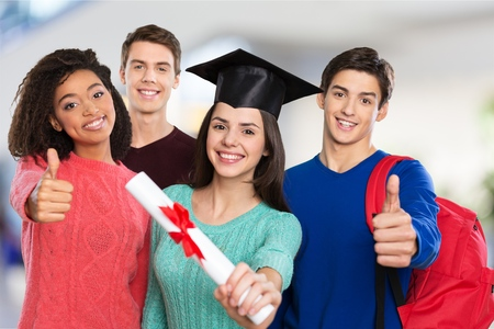 Four happy college students after graduating