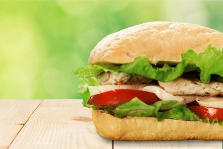 Sliced ham sandwich on a blurred background Фото со стока
