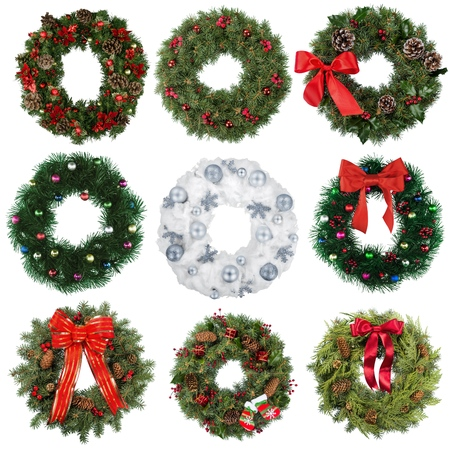 Christmas decorative wreath of holly, ivy and mistletoe isolated on a white background.
