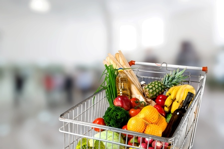 Shopping cart full with various groceries Stock fotó