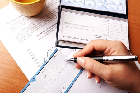 Womans Hand Writing a Check - Close Up