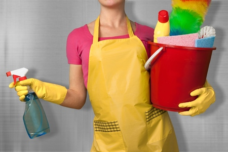 Woman in Apron with Rubber Gloves and toiletries