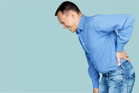 Mature man with backache on back