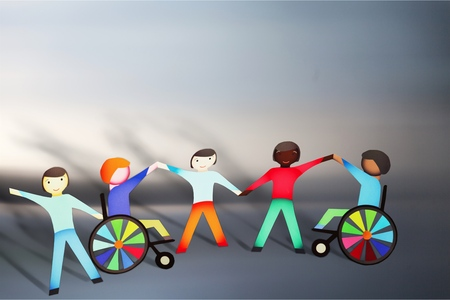 Paper People and Disabled Holding Hands Stock Photo