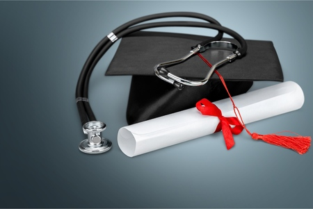 Graduation hat with tassel, diploma with red 免版税图像 - 108727907