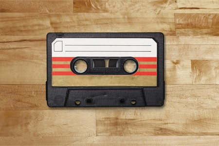 Cassette tape isolated on white Фото со стока