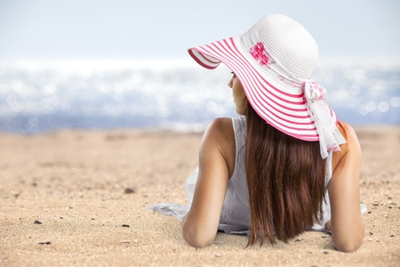 Young woman in straw hats lying on Stock Photo