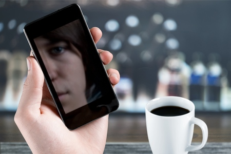 Young business man with phone and coffee Stock Photo