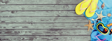 Beach accessories on wooden background Stock Photo