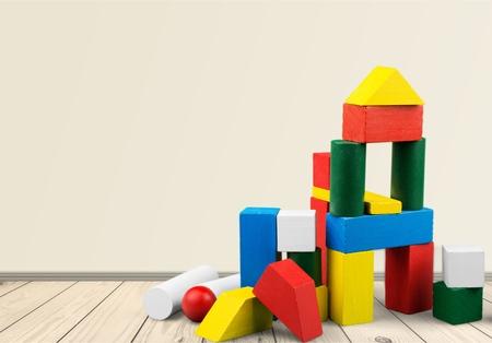 Colorful children building cubes