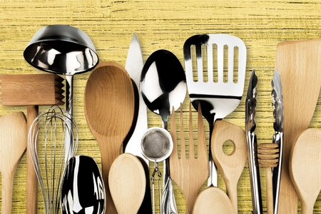 Kitchen metal and wooden utensil on  background Stock Photo