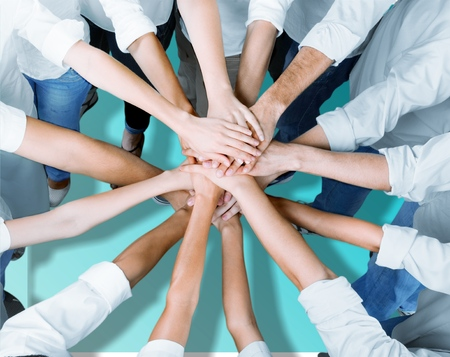 Group of people stacking hands together Stock Photo