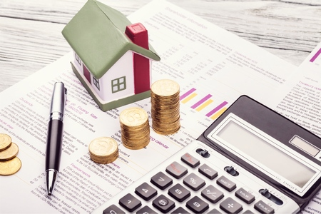 A money box and electronic calculator Stock Photo