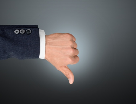 Businessman showing thumbs up over blue background